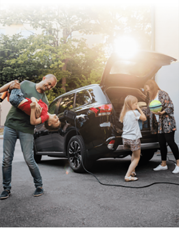 A young family loading up their car for a vacation