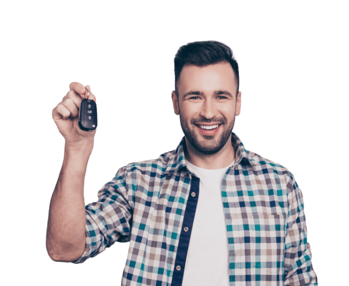 Young man holding the keys to his new car