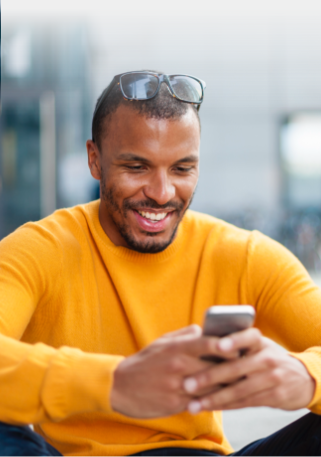 Young man using the Affinity mobile app outside