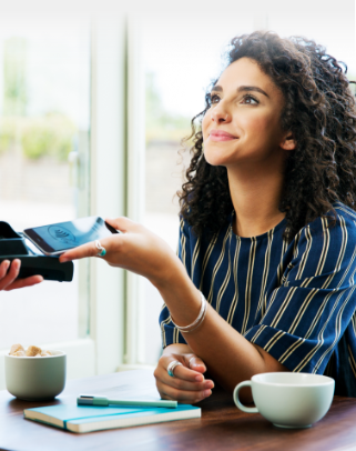 Young woman paying for dinner using her Affinity credit card